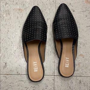 Studed black slip on shoes